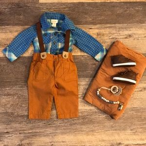 Boys newborn outfit with suspenders.